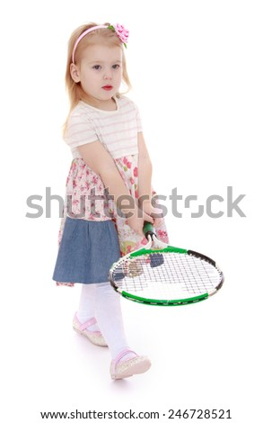 cute little girl with a tennis racket in hand.Isolated on white background - stock photo
