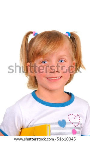 Cute little girl with a textbook - stock photo
