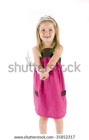 Cute little girl with a tiara and wand - stock photo