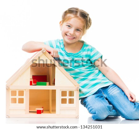 cute little girl with a toy house - stock photo