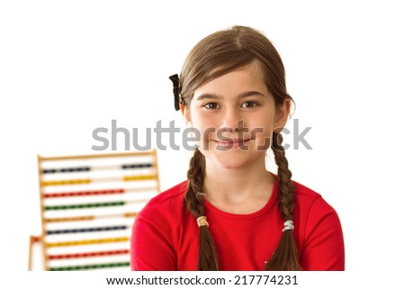 Cute little girl with an abacus on white background - stock photo