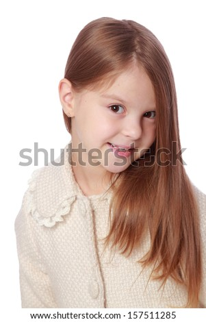 Cute little girl with beautiful healthy hair in the bright autumn coat