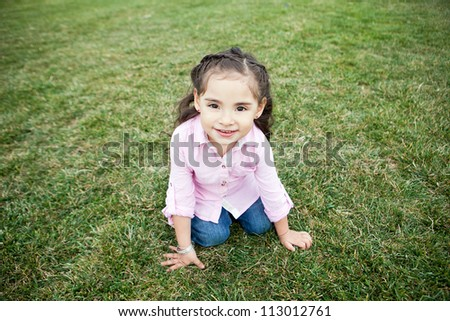 Cute little girl with big brown eyes - stock photo