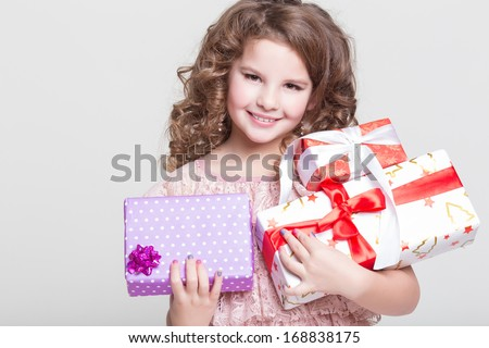 Cute little girl with birthday gift box. Happy child with gifts. Glamour baby girl hold presents. - stock photo