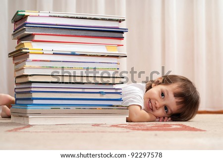 cute little girl with books in room