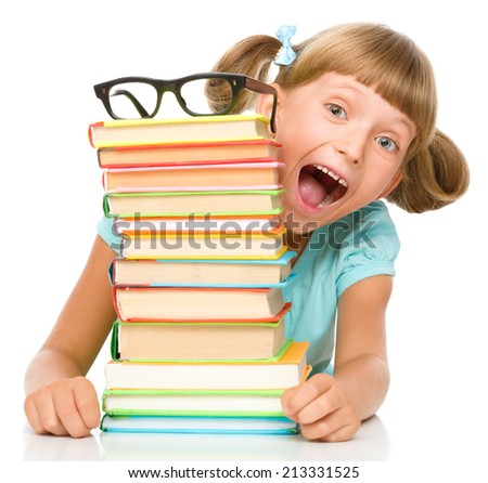 Cute little girl with books wearing glasses, isolated over white - stock photo