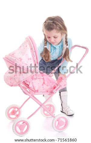 Cute little girl with carriage, isolated on white background - stock photo