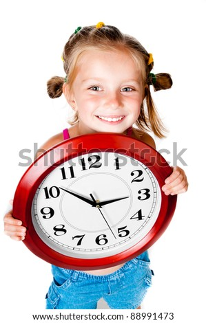 cute little girl with clock in hands - stock photo