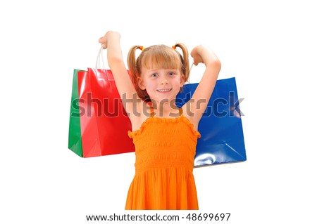 Cute little girl with colored shopping bags