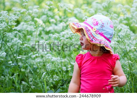 Cute little girl with colorful cap