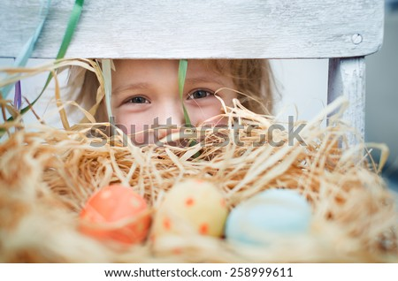 Cute little girl with  colorful easter eggs - stock photo