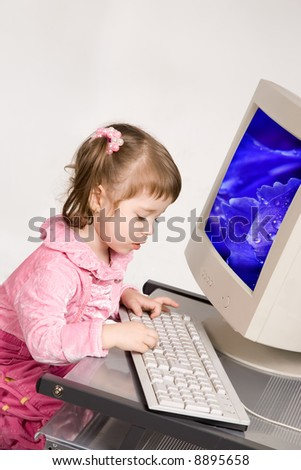 Cute little girl with computer monitor