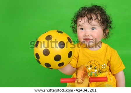 Cute little girl with curly hair - stock photo
