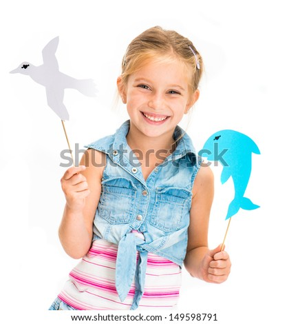 cute little girl with dolphin and gull - stock photo