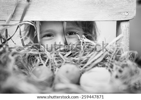 Cute little girl with easter eggs - stock photo