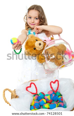 cute little girl with easter eggs and toys - stock photo