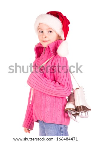 Cute little girl with figure skates - stock photo