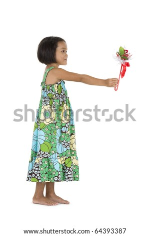 cute little girl with flower gift, isolated on white - stock photo