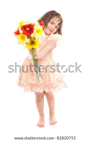 Cute little girl with flowers - stock photo