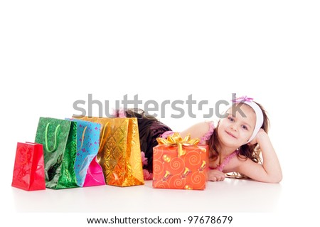 cute little girl with gifts on a white - stock photo