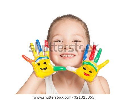 cute little girl with hands painted in colorful paints on white background - stock photo