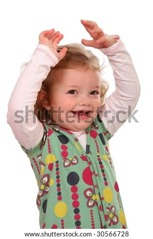 Cute little girl with her hands up above her head cheering