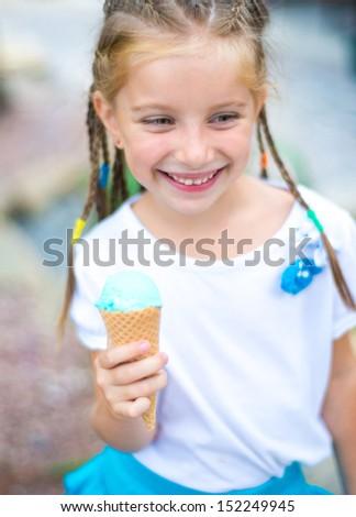 cute little girl with ice cream - stock photo