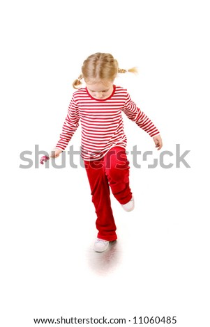 cute little girl with lollipop jumping  over white