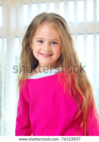 Cute little girl with long blond hair - stock photo