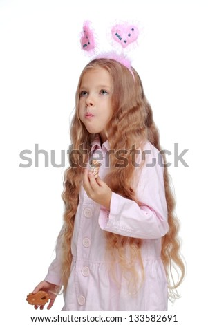 Cute little girl with long blond hair and utterly ridiculous hoop eating cookies on Food
