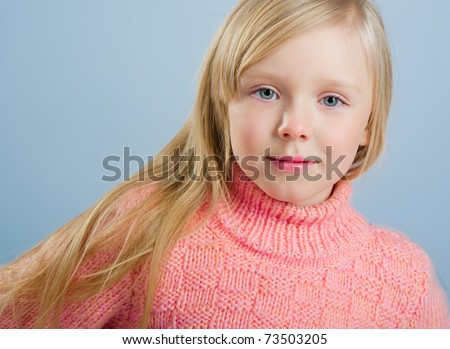 Cute little girl with long hair on a grey background - stock photo