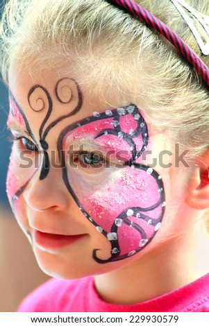 cute little girl with makeup painted face - stock photo