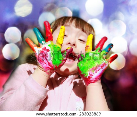 Cute little girl with painted hands - stock photo