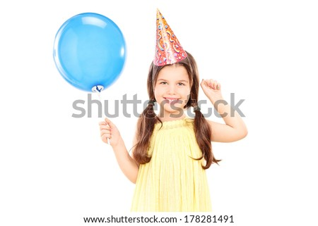 Cute little girl with party hat holding balloon isolated on white background