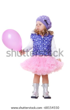 Cute little girl with pink balloon - stock photo