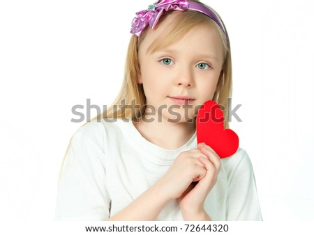 cute little girl with red heart made of paper