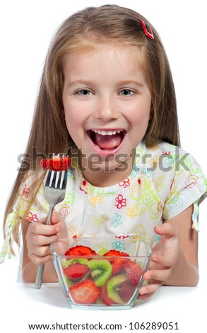 Cute little girl  with the  fruit salad on a white background - stock photo
