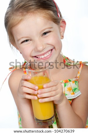 Cute little girl  with the orange juice - stock photo
