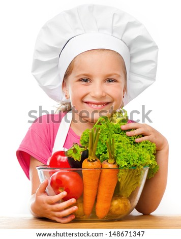 cute little girl with vegetables on a white background