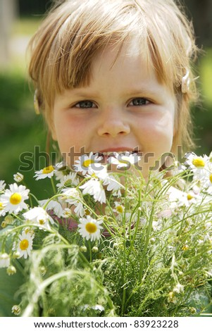 Cute little girl with white daisies outdoor - stock photo