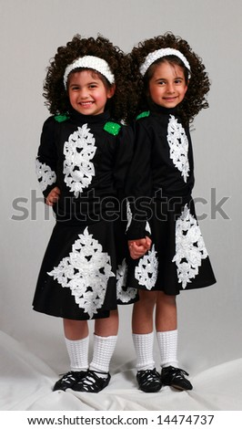 cute little girls irish dancers in costume smiling standing