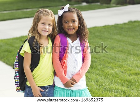 Cute Little girls walking to school together - stock photo