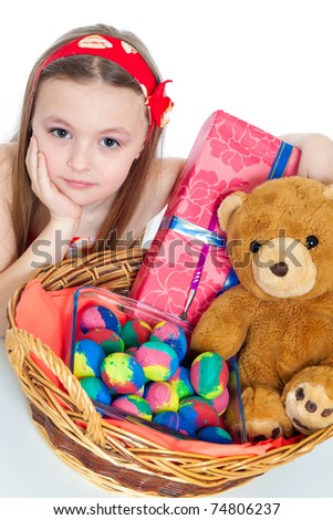 cute little girls with Easter eggs and gifts isolated on white - stock photo