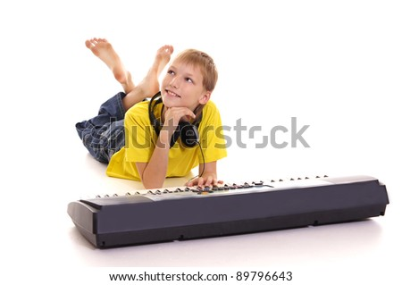 cute little guy at piano on a white - stock photo