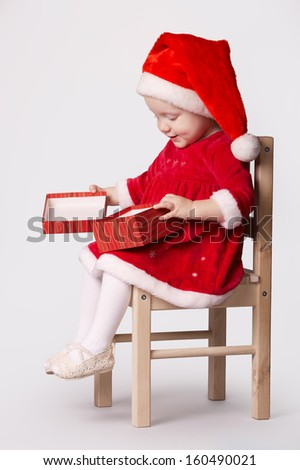 cute little happy girl with gift - stock photo