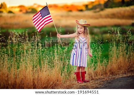 cute little kid celebrate independence day 4th july with an american flag - stock photo
