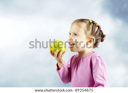 cute little kid with an apple - stock photo