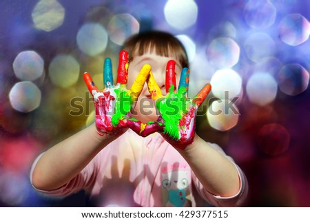 Cute little kid with painted hands. - stock photo