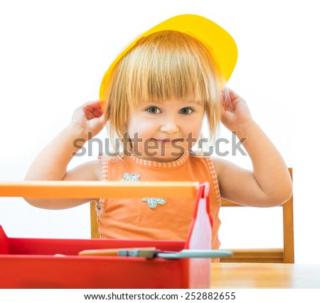 cute little kid with toy tools isolated on a white background - stock photo