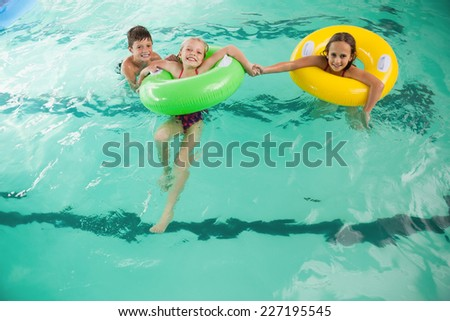 Cute little kids in the swimming pool at the leisure center - stock photo